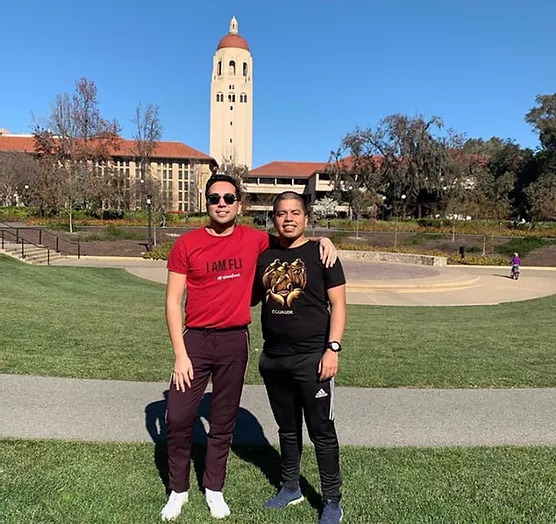 Two FGLI students posing for a picture in front of Stanford's Meyer Green space